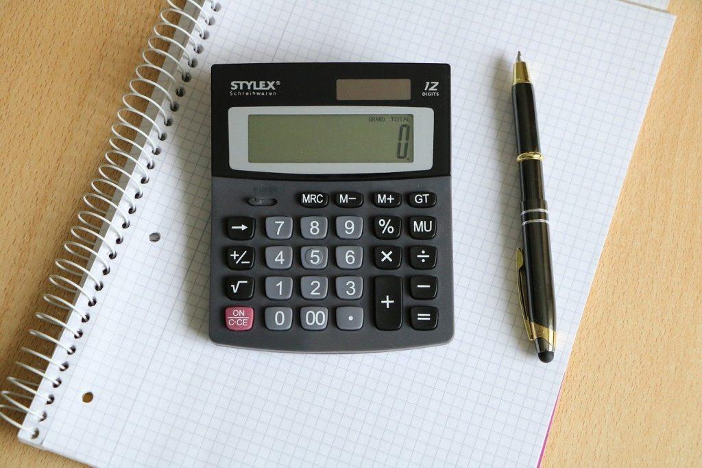 calculator, pen, block